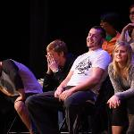 STUDENTS RESPOND TO DELUCA'S SUGGESTIONS WHILE UNDER HYPNOSIS.