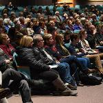 STUDENTS, FACULTY, STAFF AND MEMBERS OF THE LOCAL COMMUNITY LISTENED IN STUNNED SILENCE.