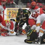 THE BULLDOGS MOVED INTO A FOURTH PLACE TIE IN THE WCHA. . .