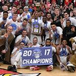 BULLDOG MEN'S BASKETBALL WON A THIRD STRAIGHT GLIAC TOURNAMENT CHAMPIONSHIP.