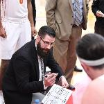 "GLIAC ""COACH OF THE YEAR"" ANDY BRONKEMA HUDDLES UP WITH THE BULLDOGS."