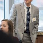PROVOST PAUL BLAKE LISTENS INTENTLY DURING THE AUTHOR CELEBRATION EVENT.
