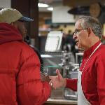 PRESIDENT DAVID EISLER CHATS WITH A STUDENT.