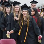 MORE THAN 1,900 GRADUATES RECEIVED THEIR DEGREES AT SPRING COMMENCEMENT CEREMONIES.
