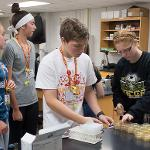 STUDENTS SPEND A WEEK IN A RESEARCH LAB ENVIRONMENT. . .