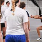 ASSISTANT VOLLEYBALL COACH CHRISTA COOPER INSTRUCTS CAMPERS ON PROPER TECHNIQUE.