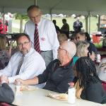PRESIDENT EISLER VISITS WITH MEMBERS OF THE FERRIS STAFF.