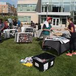 STUDENTS BROWSED THROUGH A POSTER SALE IN THE CAMPUS QUAD.