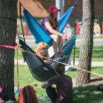 STUDENTS RELAXED ON THE QUAD TO TAKE ADVANTAGE OF THE LATE SUMMER WEATHER.