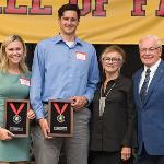 DEAN AND JOYCE DAVENPORT POSE WITH CURRENT BULLDOGS OF THE YEAR STEPHANIE SIKORSKI AND ZACH HANKINS.