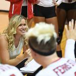 ASSISTANT COACH CHRISTA COOPER MAPS OUT SOME STRATEGY FOR THE BULLDOGS.