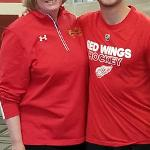 ASSOCIATE VP CARLA MILLER MEETS UP WITH FORMER BULLDOG HOCKEY STAR SIMON DENIS AT THE DETROIT RED WINGS TRAINING CAMP IN TRAVERSE CITY.