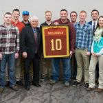 STUDENTS FROM THE VETERANS ASSOCIATION RSO PRESENTED JIM McCLOUGHAN WITH A FOOTBALL JERSEY.