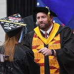 A NEW ALUMNA IS WELCOMED BY JEREMY MISHLER, EXECUTIVE DIRECTOR OF THE FSU ALUMNI ASSOCIATION.