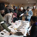 PARTICIPANTS SIGN IN FOR THE ANNUAL MARTIN LUTHER KING FREEDOM MARCH. . .