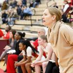 WOMEN'S BASKETBALL HEAD COACH KENDRA FAUSTIN CALLS A PLAY FROM THE BENCH.