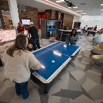 STUDENTS PLAY AIR HOCKEY IN NORTH RESIDENCE HALL