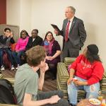 PRESIDENT DAVID EISLER ENGAGES WITH STUDENTS AT THE LGBTQ+ RESOURCE CENTER OPEN HOUSE.
