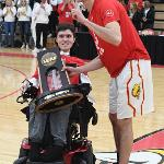 THE REGIONAL CHAMPIONSHIP TROPHY WAS PRESENTED TO MITCHELL PETERSON.