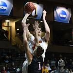 ZACH HANKINS HAD 19 POINTS AND SCORED THE WINNING BASKET IN A 71-69 WIN OVER NORTHERN STATE IN THE TITLE GAME.
