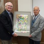PHARMACY DEAN STEPHEN DURST HONORS PROFESSOR ADNAN DAKKURI AT HIS RETIREMENT RECEPTION.