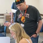 STUDENTS RECEIVED THEIR STUDENT I.D. AND COULD REVIEW THEIR FINANCIAL AID STATUS AT ORIENTATION.