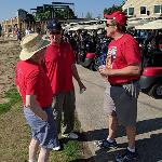 A GROUP OF BULLDOG LOYALISTS MAP THEIR GOLFING STRATEGY.