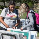 A POSTER SALE IN THE QUAD WAS SPONSORED BY THE CENTER FOR LEADERSHIP, ACTIVITIES AND CAREER SERVICES.