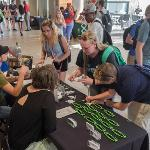 FREE NOVELTIES WERE SNAPPED UP BY FSU STUDENTS.