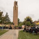 THE CELEBRATION WAS HELD IN THE NORTH QUAD AT THE BASE OF THE TOWER NEAR THE MUSIC CENTER.