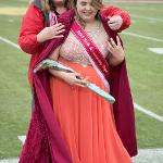 HOMECOMING ROYALTY TAYA TREIBER RECEIVES HER CAPE FROM JEANINE WARD-ROOF, VP FOR STUDENT AFFAIRS.