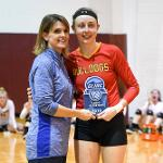 "BULLDOG KATIE PLACEK RECEIVES HER ""LIBERO OF THE YEAR"" AWARD FROM GLIAC COMMISSIONER KRIS DUNBAR."