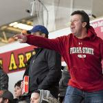 ALUMNUS JOHN MILAN ENCOURAGES THE BULLDOGS DURING THE UP-AND-DOWN HOCKEY ACTION.