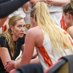 HEAD COACH KENDRA FAUSTIN MAPS OUT STRATEGY DURING A TIME-OUT.