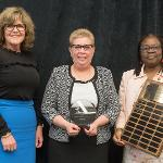 KIM HANCOCK (CENTER) WAS RECOGNIZED WITH THE HELEN GILLESPIE FERRIS DISTINGUISHED WOMAN LEADER AWARD.