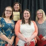 """THE """"CRIMSON & GOLD TEAM,"""" WHICH FOCUSED ON STUDENT YIELD, EARNED THE DISTINGUISHED TEAM AWARD."""