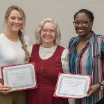 ALL-CONFERENCE WOMEN'S BASKETBALL STAR ALEXIS BUSH (L) JOINED ASSISTANT COACH SHARONDA HURD TO RECEIVE THE SENATE'S CERTIFICATE OF ACHIEVEMENT.