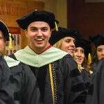 OVER 1,600 GRADUATES CROSSED THE STAGE DURING CEREMONIES ON THE MAIN CAMPUS AND IN GRAND RAPIDS.
