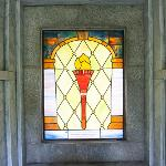 THE STAINED GLASS WINDOW INCORPORATES THE FERRIS TORCH. . .