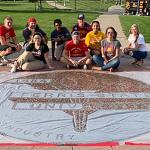"""THE STUDENT ALUMNI GOLD CLUB HELD ITS ANNUAL """"COVER THE SEAL"""" EVENT ON THE CAMPUS QUAD."""