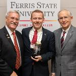 "DR. MICHAEL CROWE ('05 and '09) RECEIVED THE ALUMNI ASSOCIATION'S ""PACESETTER AWARD"" AT FALL REUNION."