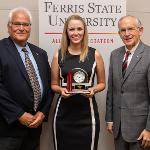 "PHARMACY STUDENT MARI SUOKKO WON THE ""ABOVE AND BEYOND"" AWARD AND IS PICTURED WITH FORMER DISTINGUISHED ALUMNUS JOHN BRADEC AND PRESIDENT EISLER."