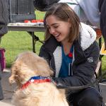 REGISTERED SUPPORT AND ASSISTANCE DOGS AND THEIR OWNERS GREETED GUESTS IN THE QUAD.