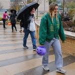 STUDENTS, EMPLOYEES AND LOCAL RESIDENTS GATHERED IN THE CAMPUS QUAD. . .