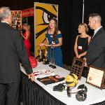 GUESTS BROWSED DISPLAYS SHARING THE STUDENT EXPERIENCE AT FSU. . .