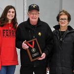 "VOLLEYBALL STAR ALLYSON CAPPEL RECEIVED HER ""DEAN DAVENPORT BULLDOG OF THE YEAR"" AWARD FROM DEAN AND JOYCE DAVENPORT."