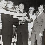 Basketball coach Jim Wink (far right) celebrates a championship with former Ferris president Victor Spathelf.