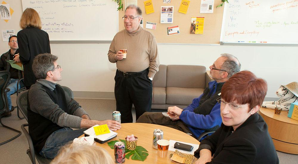 Faculty gather to discuss teaching tools.