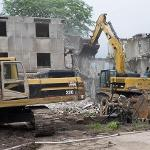 HELEN FERRIS HALL WAS DEMOLISHED TO OPEN UP THE GREEN SPACE IN THE CAMPUS QUAD.