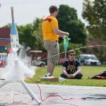 THE MAKING AND LAUNCHING OF BOTTLE ROCKETS OFFERED A TEAM-BUILDING EXERCISE FOR SUMMER CAMPERS.